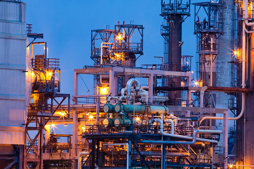 exterior shot of an oil refinery at dawn