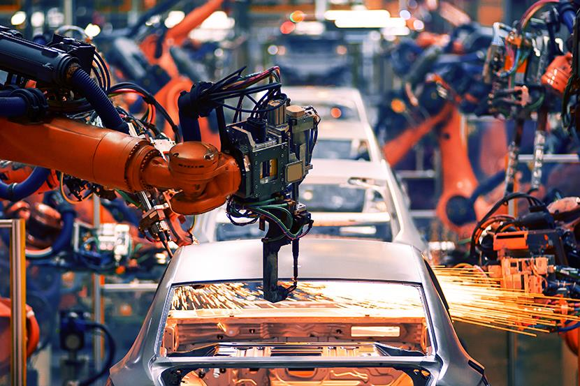 robot arm throwing sparks in automobile assembly line production