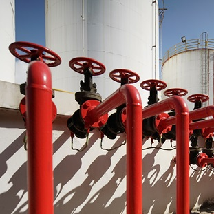 oil pipeline with red valves in oil refinery