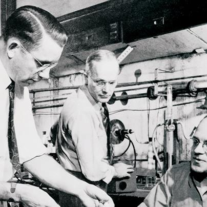 black and white photo of dr roy plunkett and two other dupont chemists