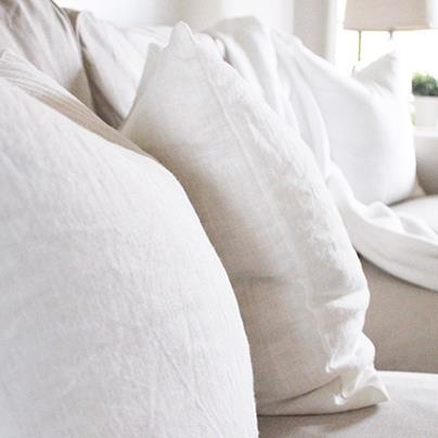 closeup of white cushion on white couch