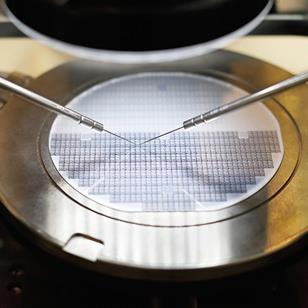 semiconductor silicon wafer undergoing probe testing