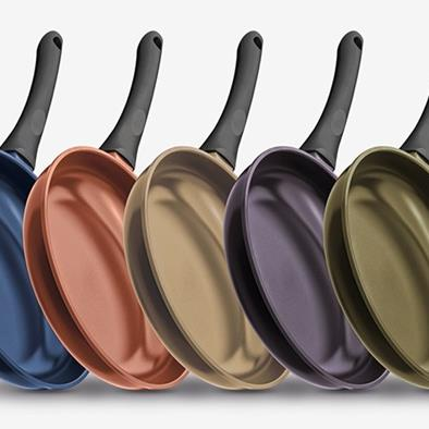series of 5 different color teflon pans