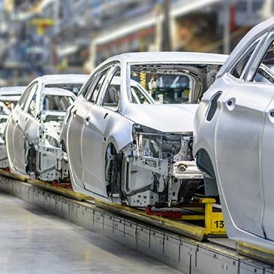 white cars on factory production assembly line